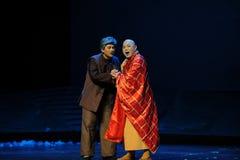 Bitten Sie Almosen Jiangxi-Oper eine Laufgewichtswaage Stockfotos
