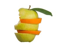 Bitten slice apples and oranges. The combination of pieces of apples and oranges royalty free stock photos