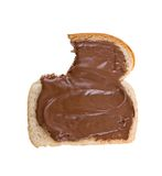 Bitten slice of bread. Covered with Hazelnut and chocolate spread royalty free stock images