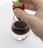 Bitten strawberry chocolate liqueur hand Royalty Free Stock Images