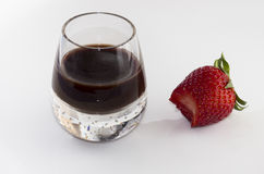 Bitten strawberry chocolate liqueur Royalty Free Stock Image