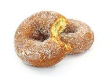Bitten sugared cake doughnuts Stock Photos