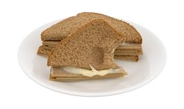 Bitten tofu turkey sandwich with mayo on a plate Stock Photography
