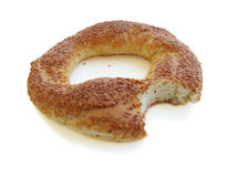Bitten Turkish Bagel. Bitten bagel with sesame isolated on white Royalty Free Stock Photo