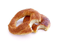 Bitten Turkish Bagels. With sesame isolated on white Royalty Free Stock Photography