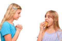 Bitten um Nahrung Stockfoto