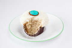 Bitten vanilla sprinkle cupcake Royalty Free Stock Image