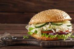 Bitten veggie burger on a wooden background Stock Images
