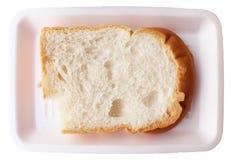 Bitten white bread. A single fresh slice of bitten white bread on plate Royalty Free Stock Photos