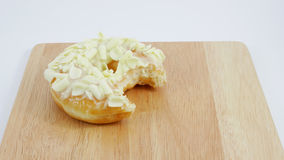 Bitten white chocolate donut (doughnut) Stock Images