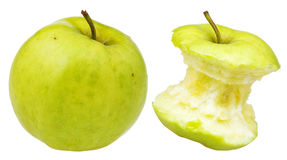Bitten and whole granny smith apple Royalty Free Stock Photography
