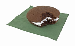Bitten whoopie pie on green napkin Stock Images