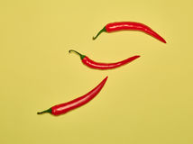 Bitter chili pepper and paprika on a yellow background Royalty Free Stock Photos