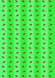 Bitter chilipeppar och paprika på en grön bakgrund Royaltyfria Bilder