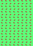 Bitter chilipeppar och paprika på en grön bakgrund Arkivbilder