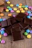 Bitter chocolate and color coated smarties Stock Images