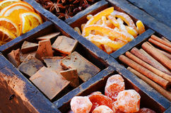 Bitter chocolate, sugared oranges and spices set Stock Image