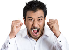 A bitter displeased grumpy man with wide open mouth fists in air almost ready to knock someone down Stock Photos