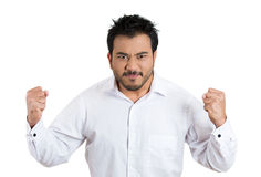 Bitter, displeased young handsome man with fists in the air, ready to punch in anger Royalty Free Stock Photos