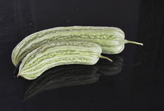 Bitter gourd on black counter Royalty Free Stock Images
