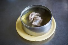 Bitter gourd soup pork ribs in metal bow soup delicious meal. Steam Bitter gourd soup pork ribs in metal bow soup delicious meal royalty free stock photography