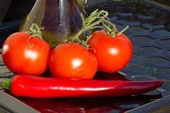 Bitter peppar och tomater Arkivbild