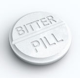 Bitter Pill Hard Medicine to Swallow Word Prescription Tablet. Bitter Pill words on a white tablet to illustrate medicine that is difficult to swallow or an idea Stock Photo