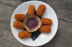 Dutch fast food Bitterballen with a spicy chili dip on a little plate royalty free stock photography