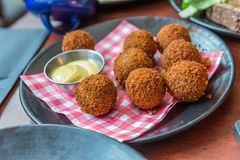 Bitterballen, a typically Dutch food croquet. With mayo royalty free stock photo