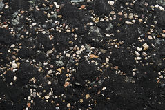Bitumen. Pebble in bitumen. oil road-building, solid sort stock photos