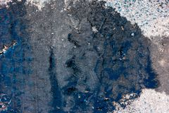 Bitumen on asphalt with traces of tires. From above royalty free stock image