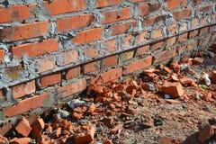 Close up on bitumen waterproofing membrane on brick house wall foundation. Bitumen waterproofing membrane on brick house wall foundation royalty free stock photos