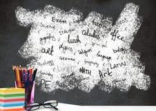 Biurka przedpole z blackboard grafika szkolni tematy zdjęcie stock