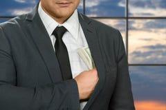 Biurowy administrator chuje dolary Zdjęcie Royalty Free