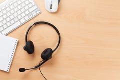 Biurowy biurko z słuchawki Centrum telefonicznego poparcie Obrazy Royalty Free