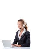 Biurowy kierownik pisać na maszynie na laptopie odizolowywającym dalej Obraz Stock