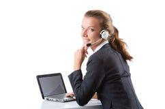 Biurowy kierownik pisać na maszynie na laptopie odizolowywającym na bielu Zdjęcie Royalty Free