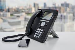 Biurowy telefon i telefon komórkowy Fotografia Royalty Free