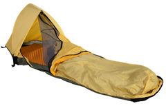 Bivy sack for solo expedition camping. Yellow bivy sack for minimalist solo expedition camping, open entry with mosquito net, foam sleeping pad inside, isolated Royalty Free Stock Images