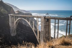 The Bixby Bridge, in Big Sur California, is one of the well known landmarks on the Pacific Coast Highway also known as California. Route 1 royalty free stock image