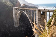 The Bixby Bridge, in Big Sur California, is one of the well known landmarks on the Pacific Coast Highway also known as California. Route 1 royalty free stock photography