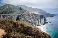 The Bixby Bridge, in Big Sur California, is one of the well known landmarks on the Pacific Coast Highway also known as California. Route 1 royalty free stock photos