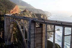 Bixby Bridge, Cliffs and Pacific Ocean in Big Sur, California. Incredible jaw-dropping landscape of Central Cal. Feat of engineering in the midst of nature& x27 royalty free stock images