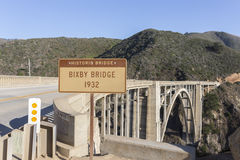 Bixby Bridge with Sign on a Beautiful Sunny Day. Bixby Creek Bridge, also known as Bixby Bridge, is a reinforced concrete open-spandrel arch bridge in Big Sur Royalty Free Stock Images