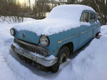 Retro car under the snow Royalty Free Stock Photography