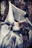 Bizarre. Shot of a twilight girl in white dress. Halloween, horror Stock Photography