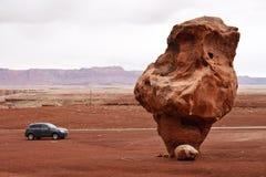 Bizarre Balanced Rock, Marble Canyon, Arizona. Bizarre Balanced Rock Dwarfs a Car near Lees Ferry, Marble Canyon, Glen Canyon National Recreation Area, Arizona royalty free stock photos