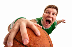 Bizarre basketball player shooting ball to basket. Portrait of bizarre basketball player shooting ball to basket. Isolated on white stock photography