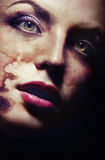 Bizarre beauty. Female vampire with skin damaged by sunburn Royalty Free Stock Photography