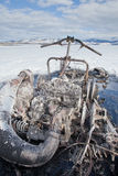 Bizarre burnt out snowmobile on Yukon lake Canada Royalty Free Stock Photo
